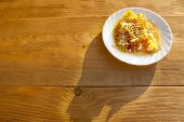 Honey comb on a white saucer — Stock Photo