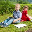 Happy Young  girl  and  boy Writing  .Smiling in summer Garden. — Stock Photo #56248013