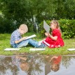 Happy Young  girl  and  boy Writing  .Smiling in summer Garden. — Stock Photo #56248053