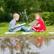 Happy Young  girl  and  boy Writing  .Smiling in summer Garden. — Stock Photo #56248069