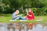 Happy Young  girl  and  boy Writing  .Smiling in summer Garden. — Foto de Stock