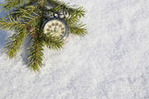 Watch lying in the snow before  new year — Stock Photo