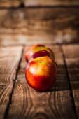 Peaches on a wooden background — Stock Photo