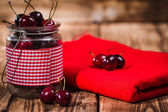 Cherry on a wooden background — Stock Photo