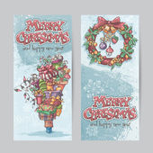 Set of vertical banners with the image of Christmas gifts, garlands of lights and Christmas wreaths with toys. — Stock Vector