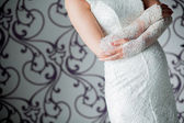 Bride putting on her white wedding dress — Stock Photo