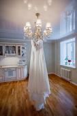 Modern white wedding dress isolated on white background — Stock Photo