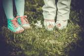Childrens and adult legs — Stockfoto