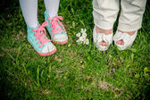 Childrens and adult legs — Stock Photo