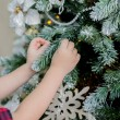 Child decorate a Christmas tree — Stock Photo #59618215