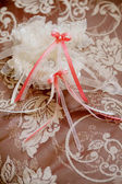 Beautiful lace wedding garter with a bow. — Stock Photo