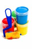 Children roller and jar with colorful paint — Stock Photo
