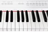 Keys of digital white piano synthesizer — Stock Photo