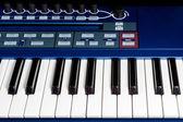 Keys blue piano synthesizer — Stock Photo