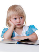 Tired child looking book — Stock Photo