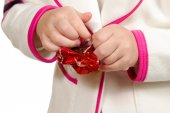 Hands unwrapping candy — Stock Photo