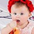 Baby takes thumb in her mouth — Stock Photo #65833681