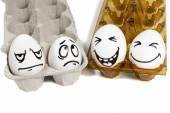 Two sad and cheerful couple eggs — Stock Photo