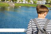 Girl looking at the river — Stock fotografie