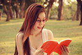 Girl is reading Book  — Photo