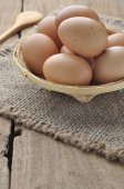 Eggs in bamboo basket. — Stock Photo