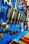 Mechanical tools placed on a cupboard, screwdrivers in focus — Stock Photo