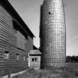 Old barn with leaning silo — Stock Photo #52972365