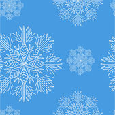 Kerstmis naadloze patroon met sneeuwvlokken op blauwe achtergrond — Stockvector