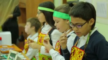 Charity fair, hungry children eat — Stock Video