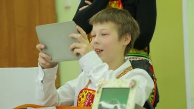 Charity fair, joyful boy plays in the tablet — Stock Video