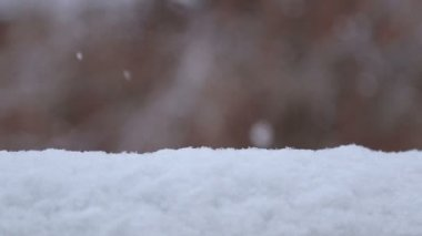 Snowflakes falling on snowdrift — Stock Video