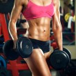 Girl with dumbbells in the gym — Stock Photo #53361859