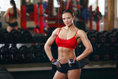 Fitness body girl in the gym — Stock Photo