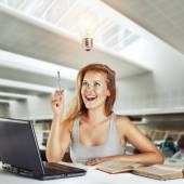 Beautiful woman came insight in the library — Stock Photo