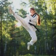 Karate woman practice martial art outdoor — Stock Photo #53630641