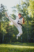 Karate woman practice martial art outdoor — Stock Photo