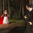 Little Red Riding Hood in the woods waiting for — Stock Photo #53733927