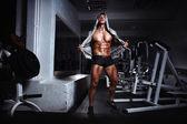 Bodybuilder man posing in the gym — Stock Photo