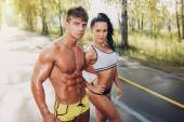 Sexy sporty couple in the park — Foto Stock