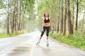 Roller skating sporty girl in otdoor. Caucasian woman in outdoor fitness activities. — Stock Photo