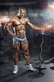 Athlete in the gym training with bar — Stock Photo