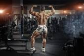Bodybuilder man posing in the gym — Stock Photo