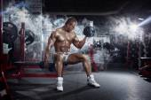Very power athletic guy , execute exercise press with dumbbells, — Stock Photo