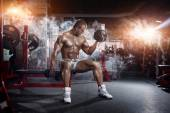 Very power athletic guy , execute exercise press with dumbbells, workout in sport hall — Stock Photo