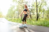 Roller skating sporty girl in otdoor. Caucasian woman in outdoor fitness activities — Stock Photo