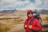 Adventure, travel, tourism, hike and people concept - man with backpack in mountain — Stock Photo