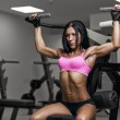 Sexy young woman exercises in gym. Fitness woman in sport wear w — Stock Photo #67909383