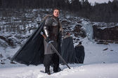 Medieval knight with sword in armor as style Game of Thrones in  — Stock Photo