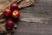 Nectarines on vintage wooden background — Stock Photo