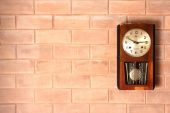 Old clock on brick wall — Stock Photo